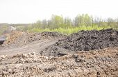 pic of loam  - A uncovered pipeline construction site with soil around - JPG