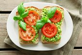pic of avocado  - Vegan sandwich with avocado and vegetables on plate - JPG