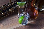 picture of saxophones  - Saxophone and alcoholic drinks on a wooden table - JPG