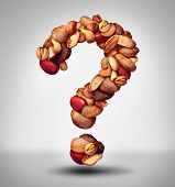 picture of mixed nut  - Nut question mark with a mixed assortment of seeds and pecan with walnut brazil nut peanuthazelnut pistachio almond and cashew as a symbol of confusion and allergy to nuts information or food facts icon - JPG