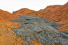 foto of scoria  - Black Lava Flow on Red Volcanic Ash on Santiago Island in the Galapagos - JPG