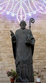 picture of luminaria  - Bronze statue with luminaria of St - JPG