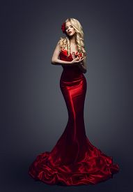 picture of tight dress  - Fashion Model Red Dress Stylish Woman in Elegant Beauty Gown Girl Posing Slinky Evening Clothes in Studio - JPG