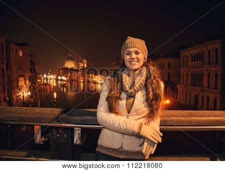 Happy Young Woman Standing On