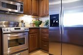 stock photo of kitchen appliance  - bright modern kitchen with new appliances - JPG