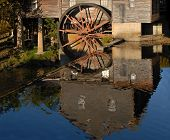 Reflection In The Water Of An Old Grist Mill