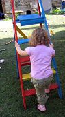 Girl Playing/ Climbing Ladder
