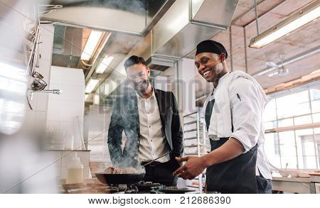 Restaurant Manager With Chef Cooking