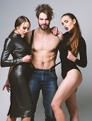 Man And Pretty Girls With Seductive Faces On Grey Background. poster