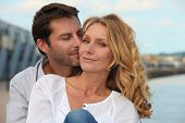 stock photo of adoration  - Portrait of a couple by the sea - JPG