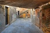 View on small  paved courtyard and vintage brick walls in Venice, Italy.
