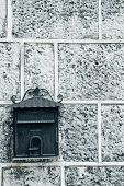 Mailbox On An Old Gray Stone Wall. Place For Text poster