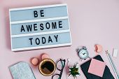 Desk Be Awesome Today On Pink Glasses Notepad Kicking Pencils Plant Macaroons Alarm Clock Top View F poster