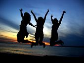 picture of beach party  - three girl friends celebrating youth - JPG