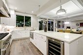Gourmet Kitchen Features White Cabinetry poster