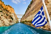 Corinth Channel In Greece And Greek Flag On Ship