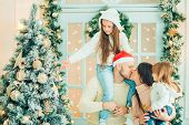 Christmas Family Portrait, Kids And Baby At Santa Hat With Present, poster