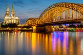 Night View of Cologne Cathedral (Kolner Dom) and Rhine river under the Hohenzollern Bridge, Cologne  poster