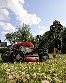 Young Boy Cutting Grass