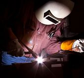 picture of tig  - A journeyman welder tig welding steel plate