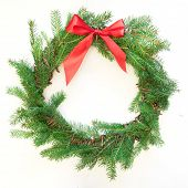 Christmas Fresh Natural Wreath From Spruce Branch With Red Bow On White Background. Square Image. poster