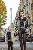 Mother And Daughter Nearby Eiffel Tower In Paris, France Walking poster