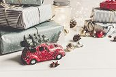 Modern Christmas Ornaments And Car Toy With Tree, Presents Cones Anise On White Wooden Background. M poster