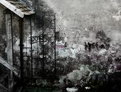 Devastated gray wall with graffiti