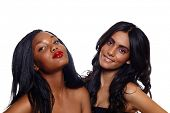 foto of black curly hair  - African beautiful woman with long extensions and red lipstick standing next to her Indian friend with long curly hair over white background - JPG