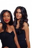 African beautiful woman with long extensions and red lipstick standing next to her Indian friend wit