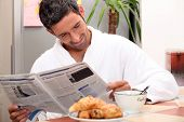 Man at kitchen table having breakfast