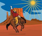 foto of bronco  - Vector art of a rodeo cowboy riding a bucking bronco