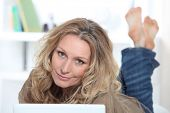 stock photo of customary  - Blond woman on laptop - JPG