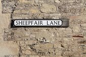 stock photo of olden days  - Road sign reflecting its past in the country village of Cold Ashton - JPG