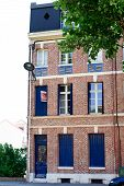 House With Blue Shutters In Amiens In France