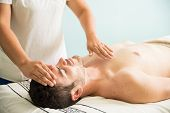 Reiki Therapy On A Young Man poster