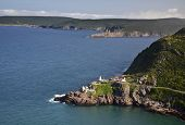 View from Signal Hill, St. John's, Newfoundland of the National Historic Site of Fort Amherst and the lighthouse on the point. The remains of gun emplacements built during WW2 are still visible.