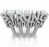 The words Strong Foundation atop large granite or marble columns to symbolize strength, resilience,