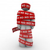 A man is wrapped in red tape with the word No representing being denied or rejected in school, work,