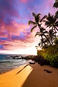 Tropical Island Paradise With Awesome Colorful Sky At Sunset And Calm Ocean Water Coming On Sandy Be poster