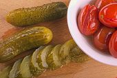 Pickles And Red Tomatoes In A Plate