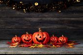 Halloween Pumpkin Lantern. Trick Or Treat On A Wooden Table poster