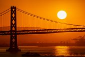 Foggy/misty Summer Morning Sunrise In California And Silhouette Of The Iconic Oakland Bay Bridge In  poster