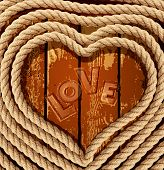 background with a heart of coiled rope on a wooden background