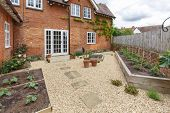 House And Garden With A Terrace Patio And French Doors, Gravel Hard Landscaping And York Stone Path poster