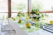 Summertime Banquet Table In Veranda With Stripy Tablecloth Decorated With Whole Lemons And Bouquets  poster