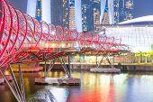 Helix Bridge At Night In Singapore poster