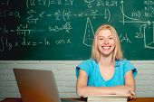Happy Student. Woman Working On Laptop Computer Over Chalkboard Background. College Student. Student poster