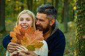 Cheerful Carefree Autumn Couple In Park On Sunny Day. Autumn Fashion Portrait Of Couple With Autumna poster