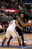 LOS ANGELES - MARCH 12: Washington Huskies G Isaiah Thomas #2 & Arizona Wildcats G Lamont Jones #12